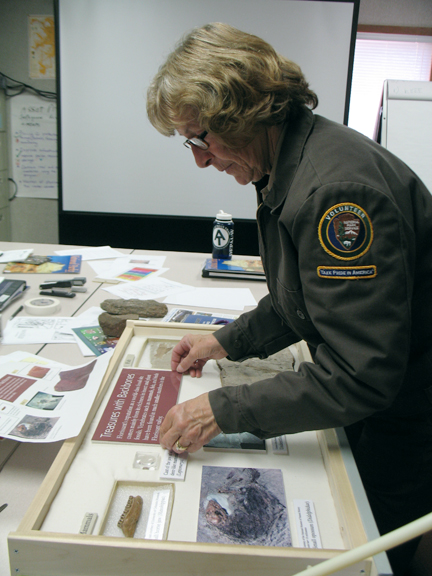 Volunteer Sally Maertens assembles an exhibit drawer
